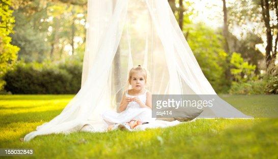 Little Girl in Canopy Under Tree