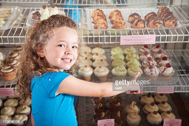 Little girl in cupcake store
