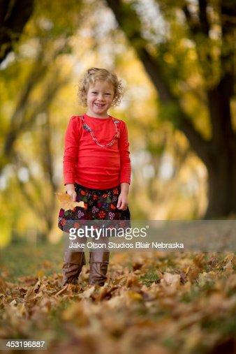 Little Girl in Fall Foliage : Stock Photo