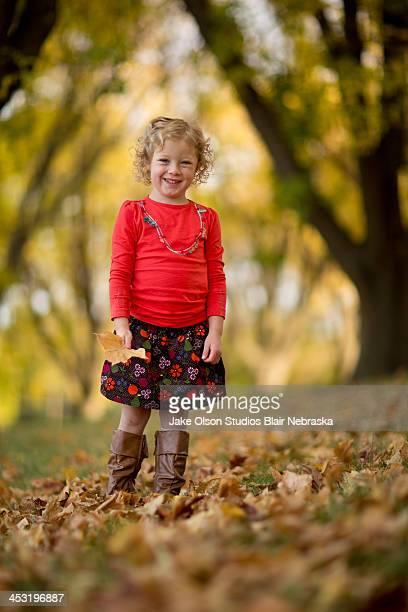 Little Girl in Fall Foliage
