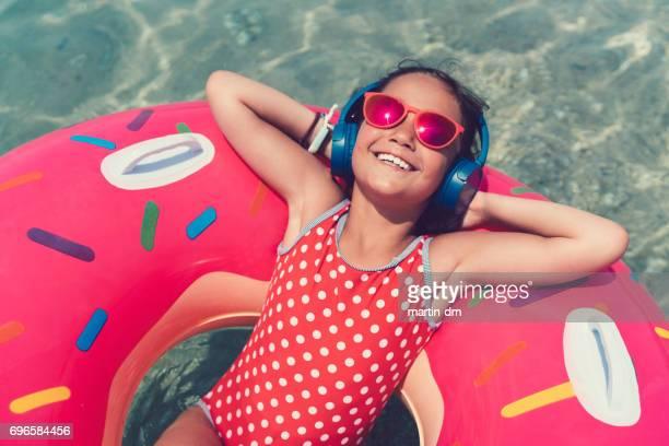 Little girl in life preserver enjoying the music