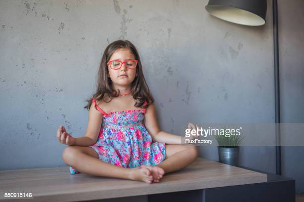 Little girl in lotus pose