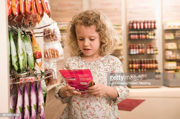Little Girl In Pharmacy, Munich, Bavaria, Germany