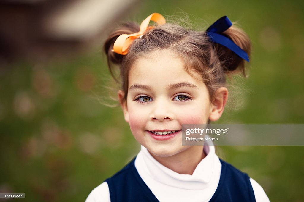 Little girl in pigtails : Stock Photo