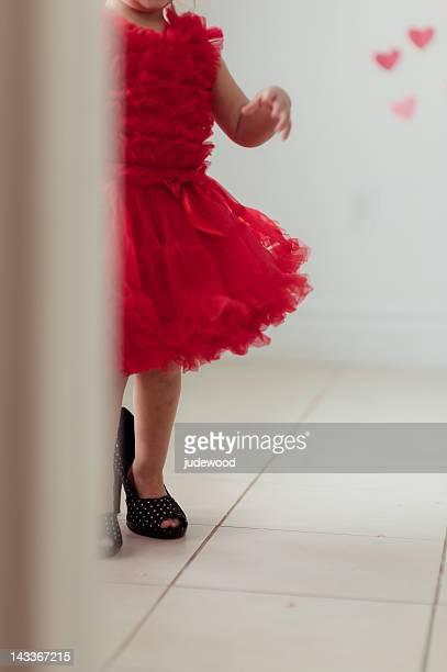 little girl in red petti dress