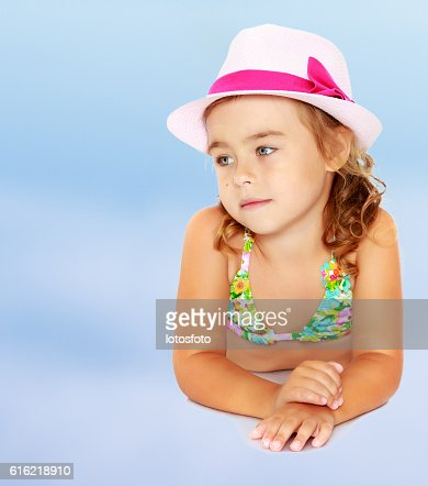 Little girl in swimsuit and hat. : Stock Photo
