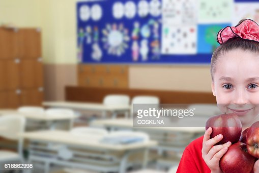 Little girl in the class : Stock Photo