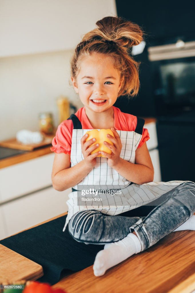 Little girl in the kitchen : Stock Photo