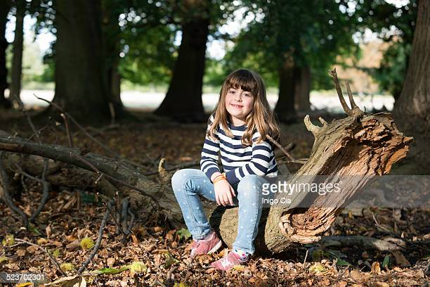 Little girl in the middle of the forest
