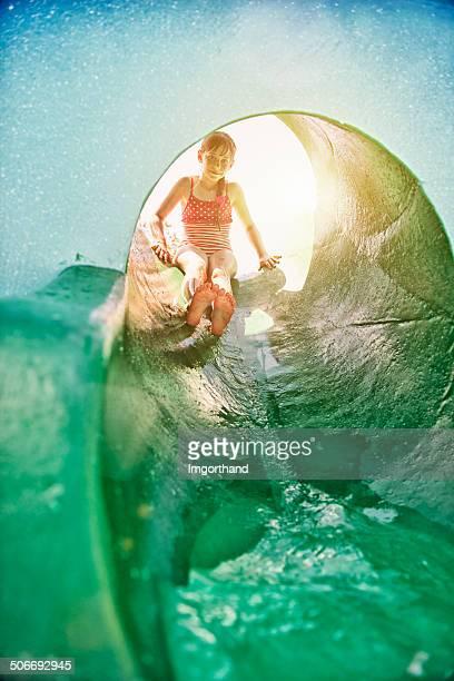 Little girl in water park slide