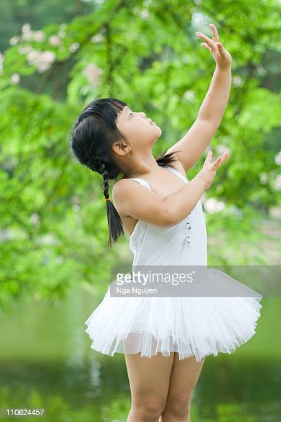 Little girl in white ballet outfit