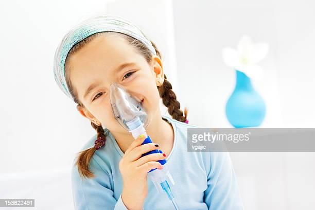 Little Girl Inhaling Cough Medicine