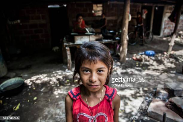 CHICHIGALPA CHINANDEGA NICARAGUA A little girl is pictured standing inside her village in the Island of Widowed Women a town that is located within...