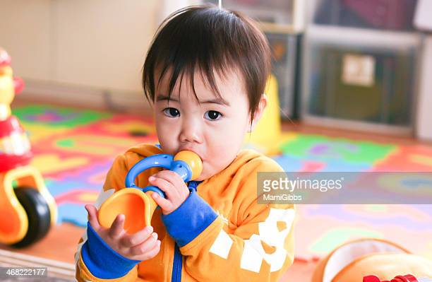 Little girl is playing with toy of Trumpet