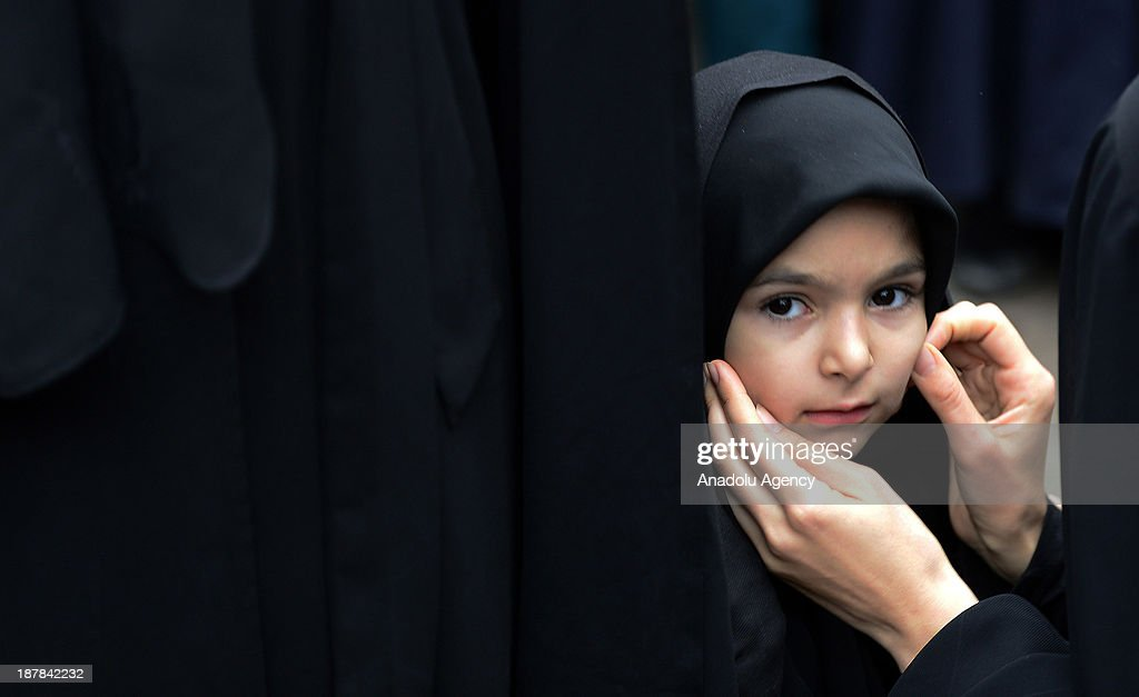 A little girl is seen at the universal Ashura Day that is held at Halkali Arena Park on November 13, 2013 in Istanbul, Turkey. Ashura day is well-known because of mourning for the martyrdom of Husayn ibn Ali, the second grandson of Muhammad, who was killed during the Battle of Karbala in 680.