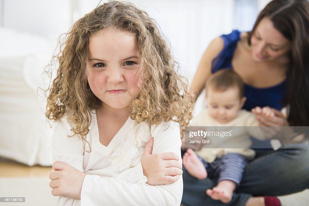 Little girl jealous of new baby