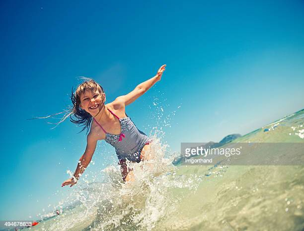 Little girl jumping in the sea