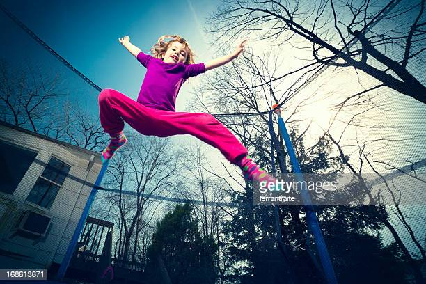 Little girl jumping on trampoline