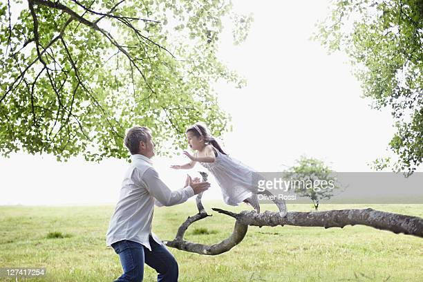 little girl jumps into her father's arms