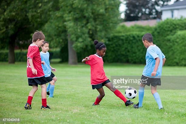 Little Girl Kicking the Ball