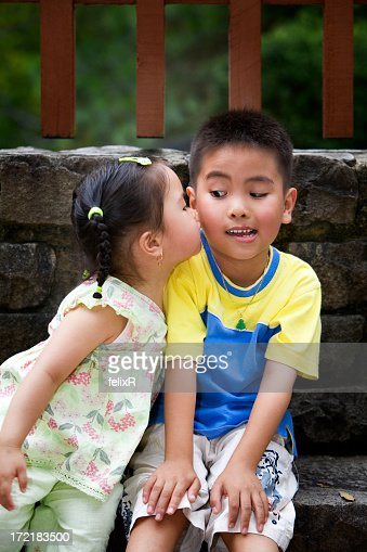 little girl kissing a little boys cheek without permission stock photo getty images