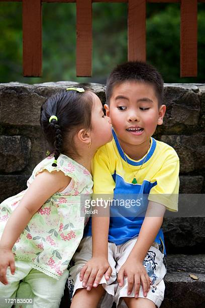 Little girl kissing a little boy's cheek without permission