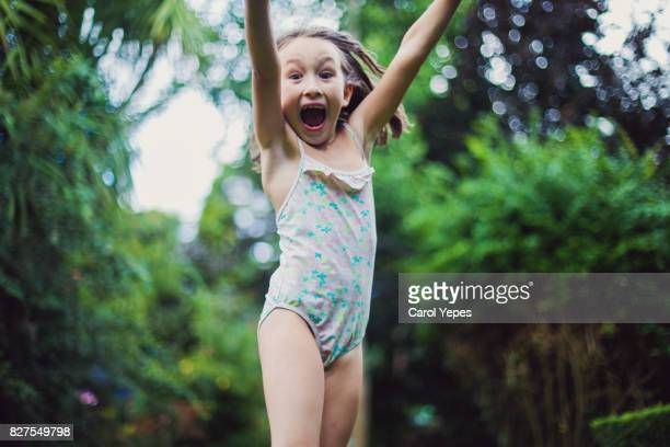 little girl laughing and jumping