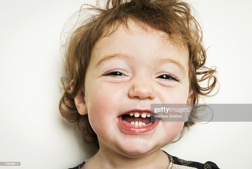 Little girl laughing with gappy teeth. : Stock Photo