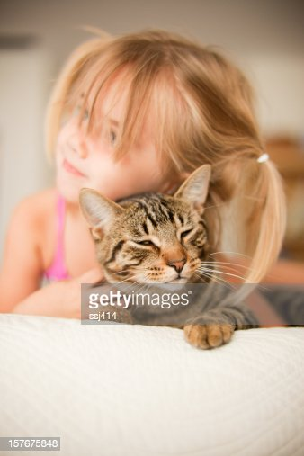 Little Girl Laying with her Cat