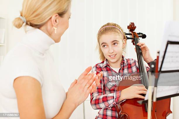 Little Girl Learning to play Cello.
