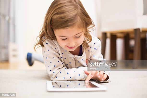 Little girl learning using digital tablet