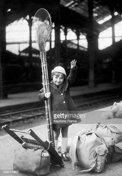 Little Girl Leaving On Easter Vacation With Her Fishing Equipment Standing On The Train Station'S Platform On April 11 1936