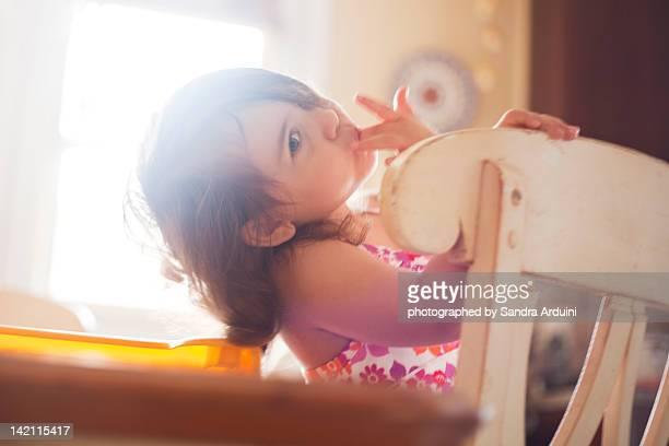 Little girl licking her fingers