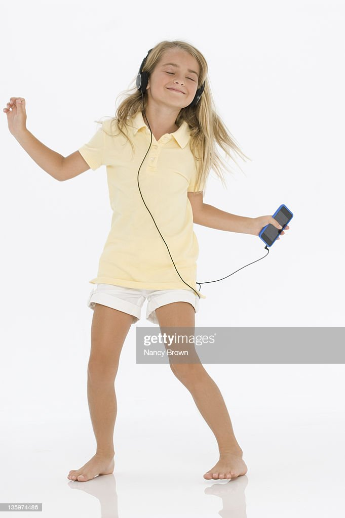 Little girl listening to music : Stock Photo