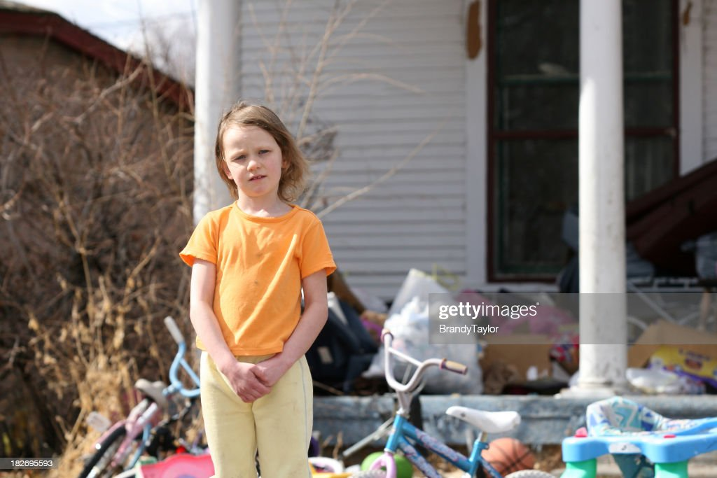 A little girl living in poverty in America : Stock Photo