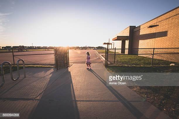 Little girl long shadows