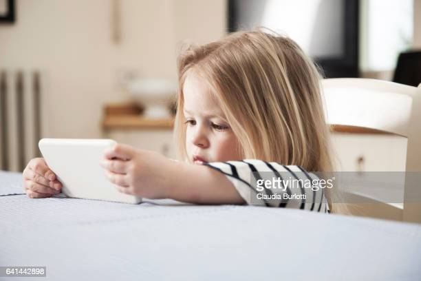 Little girl looking at a mobile