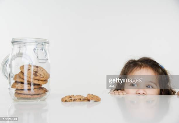 Little girl looking at cookie jar