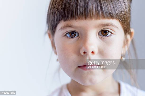 Little girl looking directly into the camera