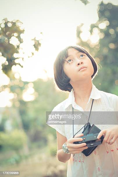 Little Girl looking for nature and taking  photo with  camera