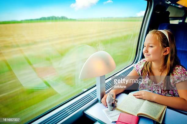 Little girl looking in the window