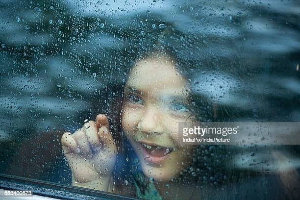 Little girl looking out of car window