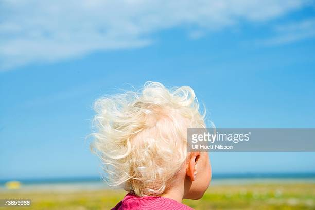 A little girl looking out over the sea.