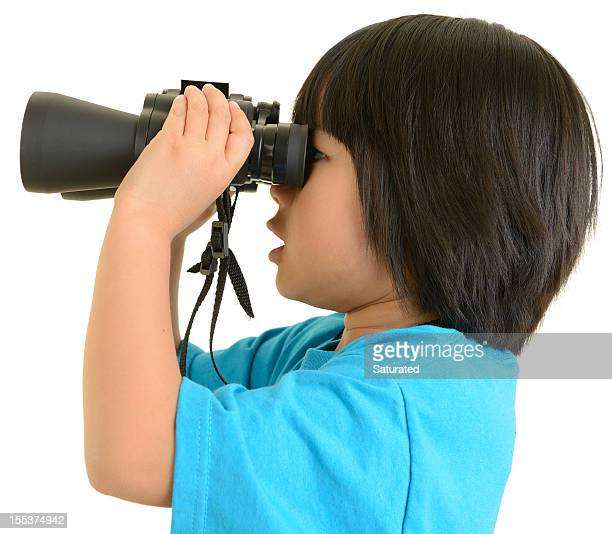 Little Girl Looking To the Side Through Binoculars