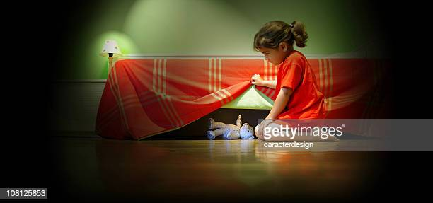 Little Girl Looking Under Bed For Teddy Bear