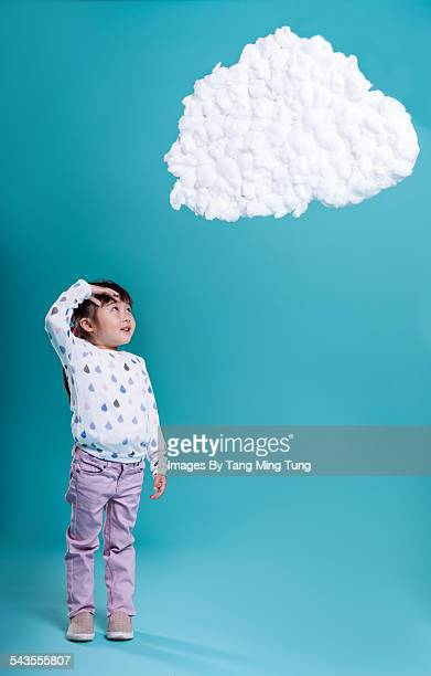 Little girl looking up at a DIY data cloud