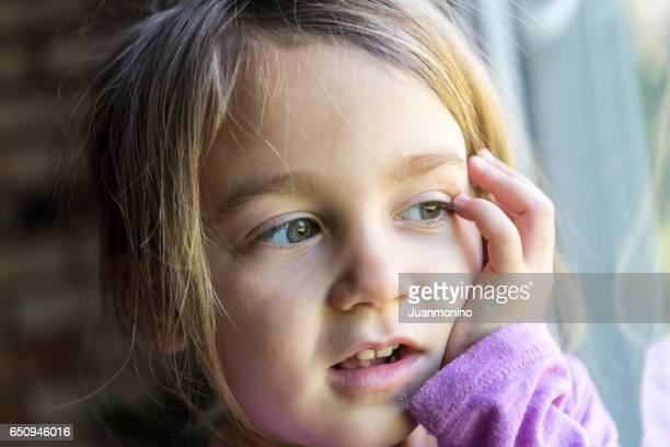 Little girl looking way