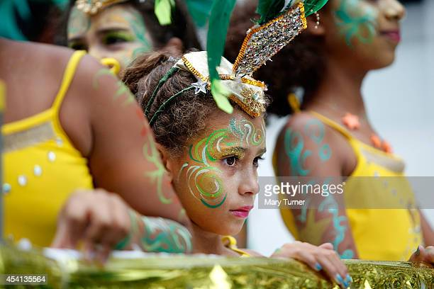 A little girl looks out from a carnival float at the rain soaked Notting Hill Carnival by on August 25th 2014 in London England Despite the bad...