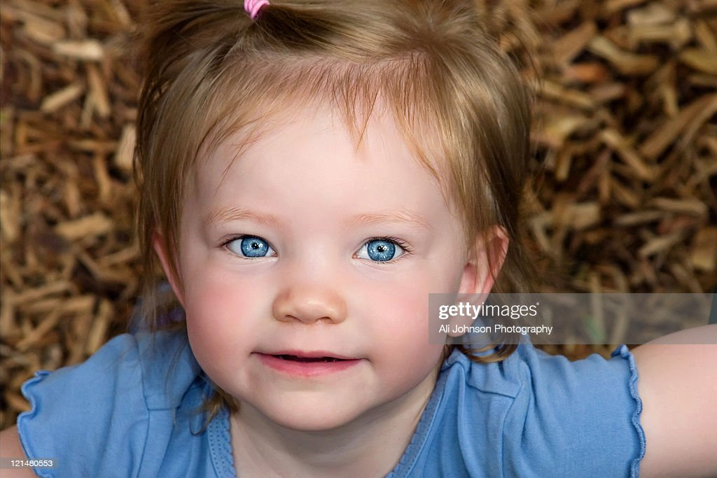 Little girl looks up : Stock Photo