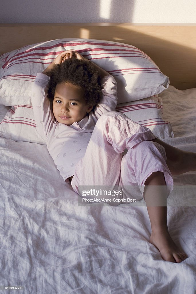Little girls on the bed